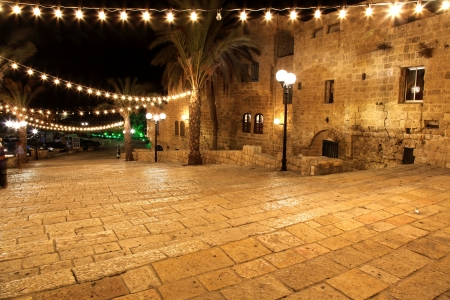 Classic Israel - Old street of Jaffa, Tel Aviv in the night photo