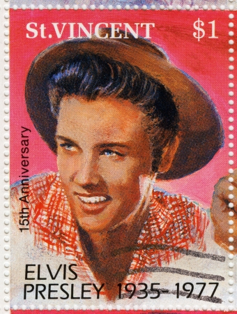 ST. VINCENT - CIRCA 1992 : stamp printed in St.Vincent - famous rock and roll singer and actor Elvis Presley, circa 1992