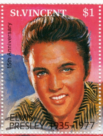 ST. VINCENT - CIRCA 1992 : stamp printed in St.Vincent - famous rock and roll singer and actor Elvis Presley, circa 1992 Stock Photo - 15837495
