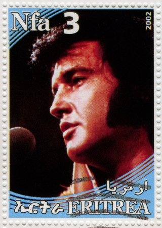 elvis presley: ERITREA - CIRCA 2002 : stamp printed in Eritrea shows famous rock and roll singer and actor Elvis Presley, circa 2002 Editorial