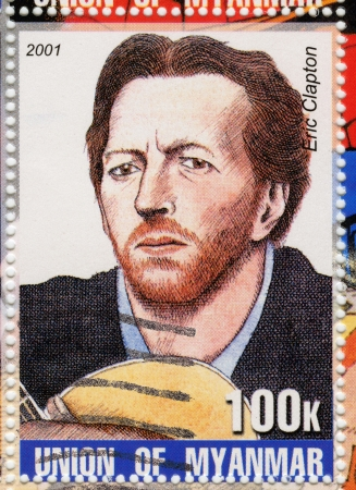 MYANMAR - CIRCA 2001 : stamp printed in Myanmar show funny cartoon pic with Eric Clapton , circa 2001 Stock Photo - 15837544