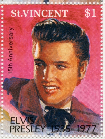 ST  VINCENT - CIRCA 1992   stamp printed in St Vincent - famous rock and roll singer and actor Elvis Presley, circa 1992 Stock Photo - 15837511