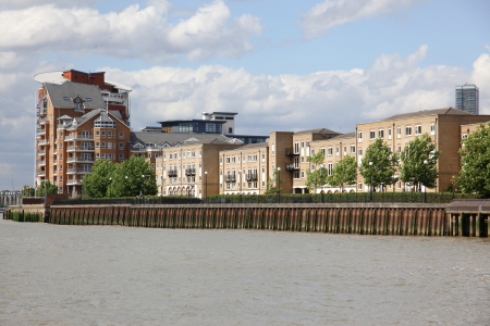 London, warehouse converted into apartments on the Thames in London, UK photo