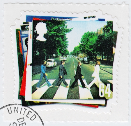 john lennon: UK - CIRCA 2003 : stamp printed in UK shows vinyl Abbey Road of the Beatles in 1960s famous musical pop group, circa 2003