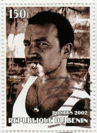 bono: BENIN - CIRCA 2002 : Stamp printed in Benin shows Bono - frontman U2 rock band, circa 2002 Editorial