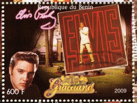 graceland: BENIN - CIRCA 2009   stamp printed in Benin - Elvis Presley against her LP and Graceland, circa 2009
