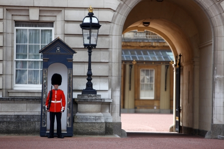 LONDON, ENGLAND- JUNE 9  Sentry of the Grenadier Guards posted outside of Buckingham Palace on June 9, 2011 in London, United Kingdom  The Grenadier Guards traces its lineage back to 1656 photo