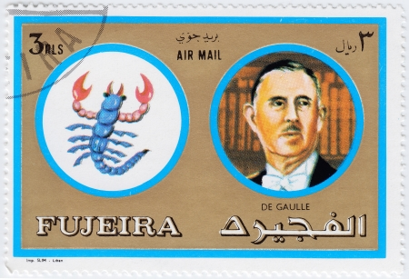 FUJEIRA - CIRCA 1971 : stamp printed in Fujeira, Zodiac Signs of Famous People  shows Charles de Gaulle and Scorpio the scorpion, circa 1971  photo