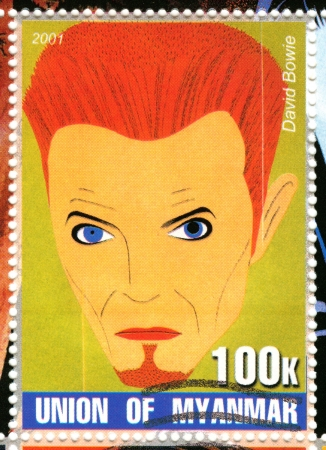 MYANMAR - CIRCA 2001 : stamp printed in Myanmar show funny cartoon pic with David Bowie , circa 2001 Stock Photo - 15854792