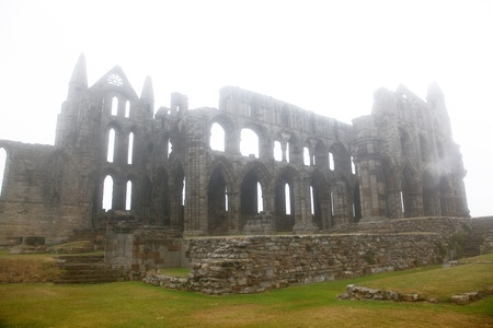 whitby: Whitby Abbey castle taken in deep fog, ruined Benedictine abbey sited on Whitbys East Cliff in North Yorkshire on the north-east coast of England, GB