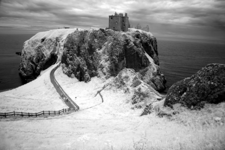 headland: Dunnottar Castle ruined medieval fortress located upon a rocky headland on the north-east coast of Scotland,  GB Stock Photo