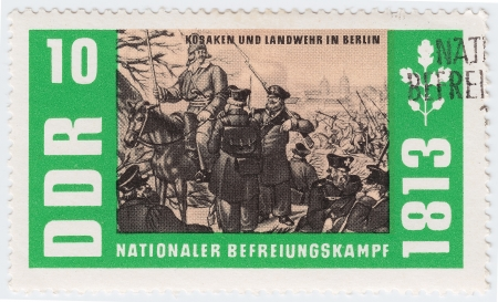 GERMANY- CIRCA 1963 : stamp printed in Germany shows russian Cossack and soldiers in Berlin in Napoleon war 1813, circa 1963 Stock Photo - 15855120