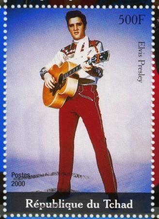 Tsjaad - CIRCA 2000: stempel gedrukt in Tsjaad - beroemde acteur en rock and roll zanger Elvis Presley, circa 2000