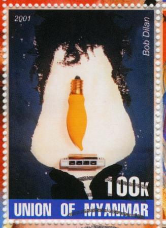 MYANMAR - CIRCA 2001 : stamp printed in Myanmar show funny cartoon pic with Bob Dylan , circa 2001 Stock Photo - 15876355
