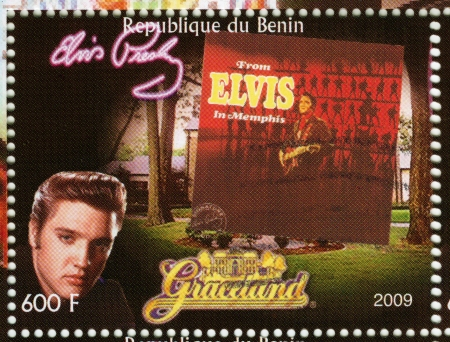 BENIN - CIRCA 2009 : stamp printed in Benin - Elvis Presley against her LP Elvis in Memphis and Graceland, circa 2009
