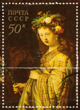 USSR - CIRCA 1980 : stamp printed in the USSR shows draw of artist Rembrandt pic Flora, circa 1980  Stock Photo - 15876426