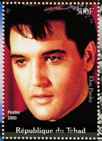 elvis presley: TCHAD - CIRCA 2000 : stamp printed in Tchad - famous actor and rock and roll singer Elvis Presley, circa 2000 Editorial