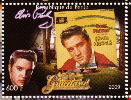 graceland: BENIN - CIRCA 2009 : stamp printed in Benin - Elvis Presley against her LP King Creole and Graceland, circa 2009 Editorial
