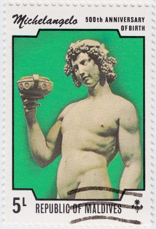 GRENADA - CIRCA 1975 : stamp printed in Grenada dedicated artist Michelangelo di Lodovico Buonarroti Simoni 500th Anniversary of birth, circa 1975 Stock Photo - 15876398