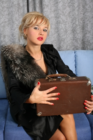 woman in vintage style with suitcase photo