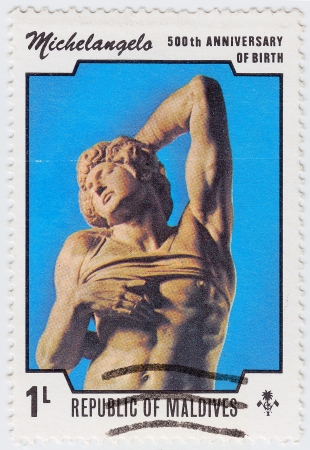 GRENADA - CIRCA 1975 : stamp printed in Grenada dedicated artist Michelangelo di Lodovico Buonarroti Simoni 500th Anniversary of birth, circa 1975 Stock Photo - 15908338