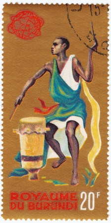 BURUNDI - CIRCA 1965 : Stamp printed in Burundi show 1965 Tribal Dancers and musician, circa 1965 photo