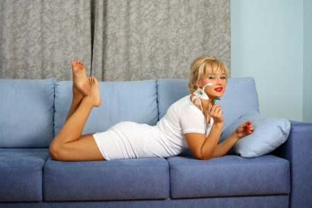 woman with lilly at sofa in room photo