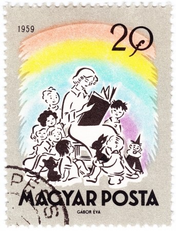 pic: HUNGARY - CIRCA 1959 : post stamp printed in Hungary shows pic woman read  tale for children, circa 1959