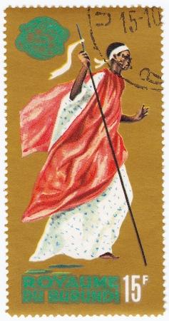 burundi: BURUNDI - CIRCA 1965 : Stamp printed in Burundi show Tribal Dancer musician, circa 1965