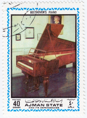 AJMAN (now emirate in the United Arab Emirates (UAE)) - CIRCA 1972 : stamp printed in Ajman shows a pic piano of Ludwig van Beethoven,  circa 1972 Stock Photo - 15909284