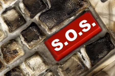 burned keyboard with red button Stock Photo - 15928401
