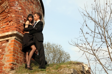 Young lovely couple beside old house photo