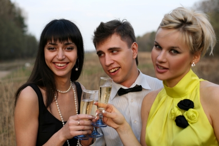 two girl and man with wine outdoors Stock Photo - 15940478