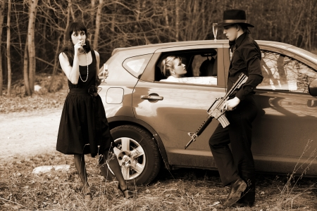 man and two woman with cigar, wine in car photo