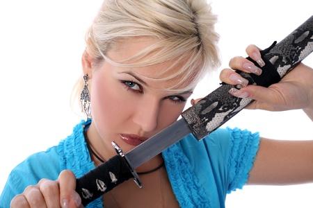 female assassin: girl holding in her hands a katana isolated on white Stock Photo