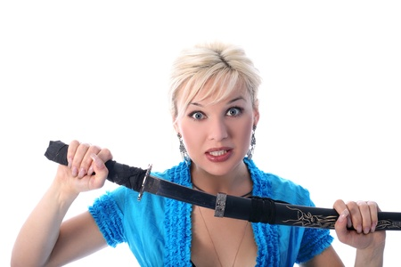 girl holding in her hands a katana isolated in white photo
