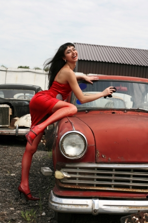 girl washing vintage car photo