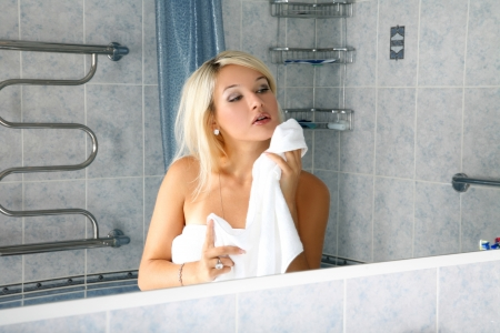 girl in bathroom with towel photo