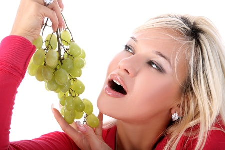 girl with green grape isolated on white photo