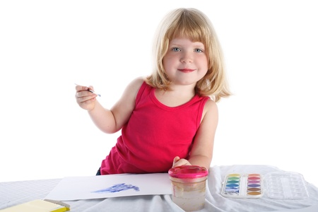 beside table: girl with paint beside table isolated on white
