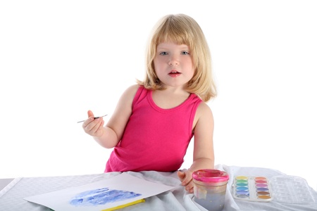 girl with paint beside table isolated on white Stock Photo - 15942208