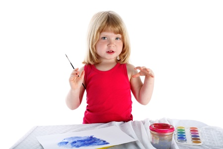 girl with paint beside table isolated on white Stock Photo - 15930159