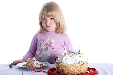 malcontent: disaffected girl with birthday cake isolated on white