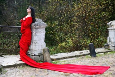 singleness: girl in fall park in old bridge