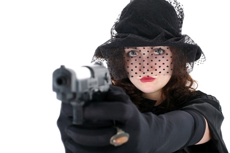 girl in hat with gun isolated on white Stock Photo