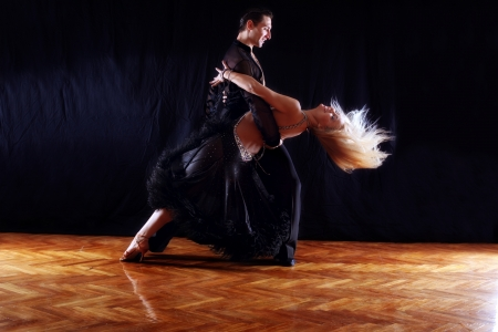 15942061: dancers in ballroom against black background