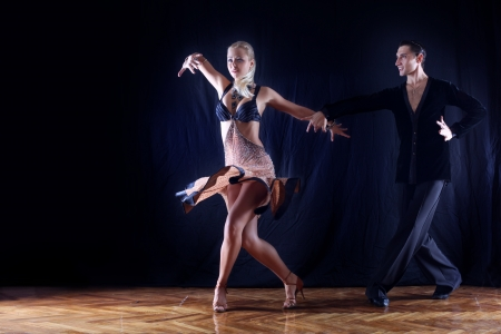 Latin man: dancers in ballroom Stock Photo