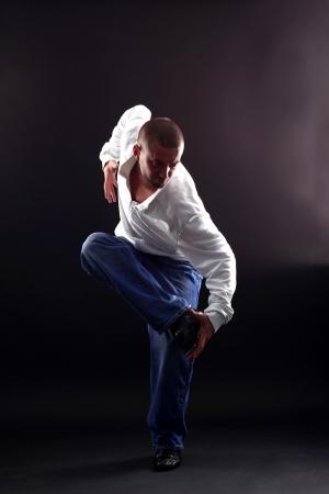 cool modern dancer against black background photo