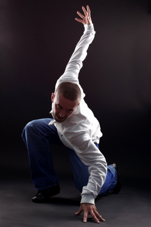 man cool modern dancer isolated on white photo