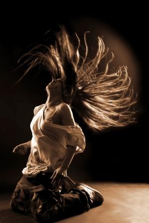 rnb: cool woman dancer against black background